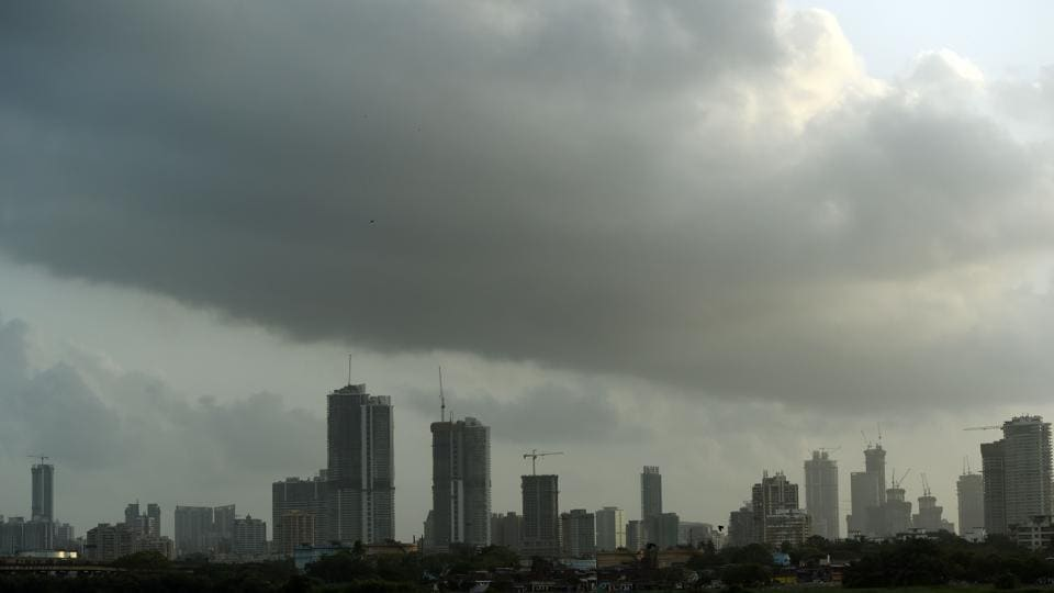Dark clouds gather over the skyline in Mumbai on May 29 as monsoon season approaches.