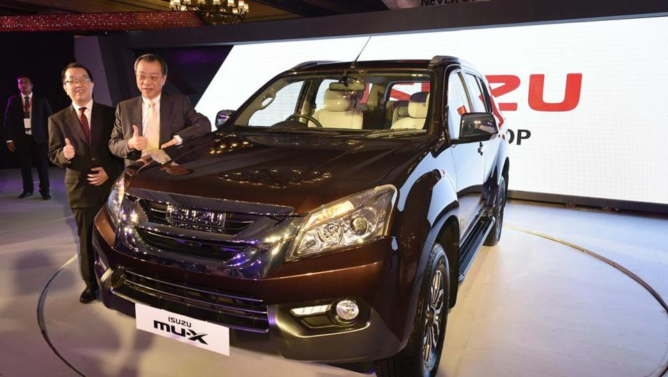 Isuzu Motors India chairman Hiroshi Naka Gawa (R) and MD Naohiro Yamaguchi (L) with the newly launched Isuzu Mu-X.
