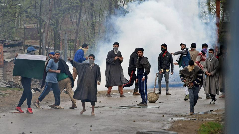 Budgam: A group of youth pelting stones on security forces during an anti-militant operation at village Durbugh in Chadoora area of central Kashmir's Budgam district.