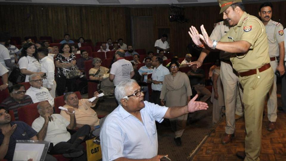 A police officer tries to placate an irate Jaypee homebuyer at the tripartite meeting in Sector 6 on Monday.
