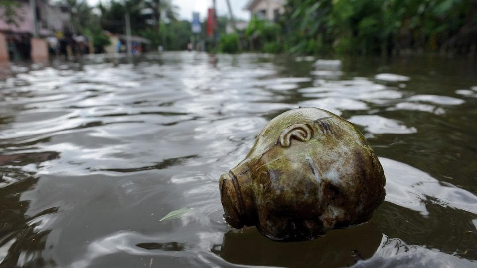 A doll's head floats in floodwaters in Dodangoda village in Kalutara. More rains are expected in the next two days as the depression in the east central Bay of Bengal intensified into a cyclonic storm 'MORA' and is now moving away from the island. (Lakruwan wanniarachchi/AFP)