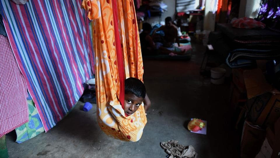 A young Sri Lankan flood victim rests at a relief camp. The relief goods, to be dispatched to Colombo by a chartered flight soon, include tents, blankets, sheets, rain boots and life jackets. (Ishara S. Kodikara/AFP)