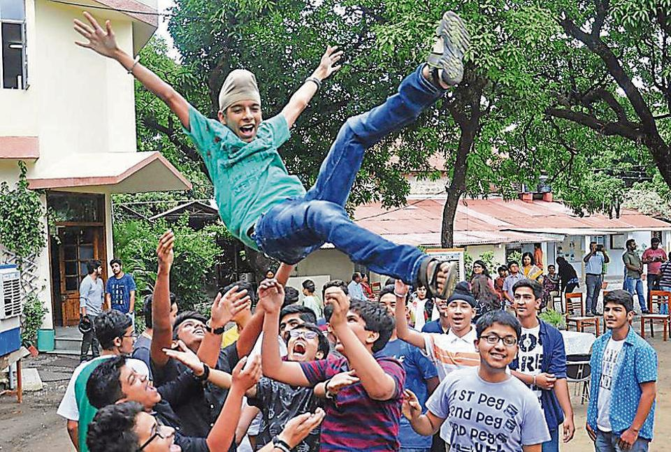 Students celebrate at Dehradun's Brightlands School after the ICSE/ISCexam results were announced on Monday.