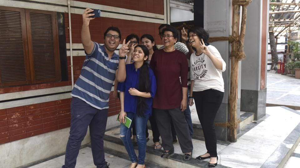 Students of Lilavatibai Podar High School takes selfie to celebrate their success in Class 12 exam on Monday.