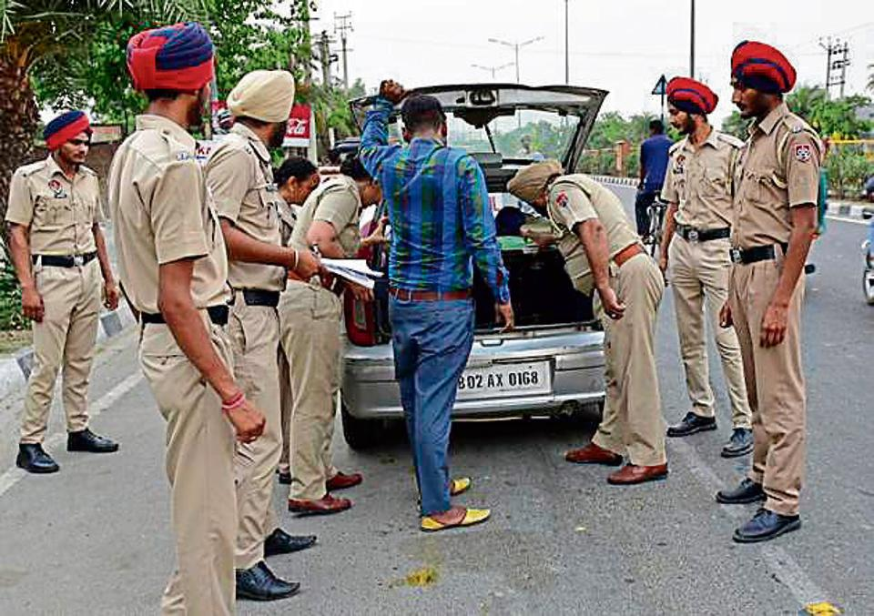 Police officials checking a vehicle ahead of Operation Bluestar anniversary in Amritsar on Tuesday.