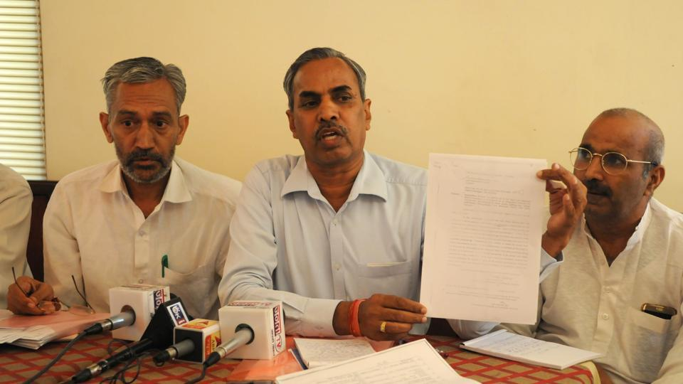 Manesar villagers address a press conference responding to state Congress leaders' allegations of fighting land acquisition at the behest of the BJP.