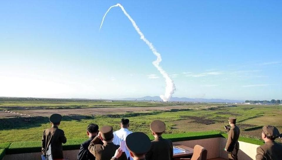 North Korean leader Kim Jong Un watches the test of a new anti-aircraft guided weapon system in this undated photo released by Korean Central News Agency (KCNA) May 28, 2017.