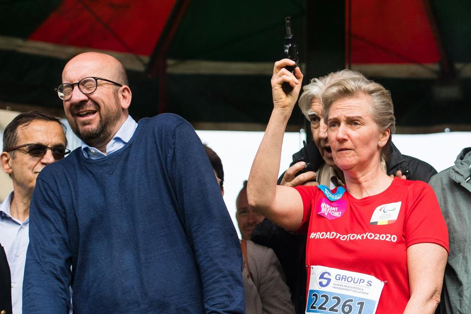 Belgian Prime Minister Charles Michel reacts as Princess Astrid fires a gun to start the Brussels' 20km run on Sunday.
