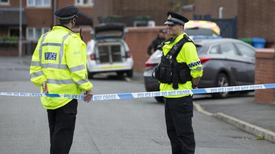 Police officers guard the entrance to a street in the Moss Side area of Manchester on May 28, 2017 during an operation. A British minister said Sunday members of suicide bomber Salman Abedi's network could still be a large.