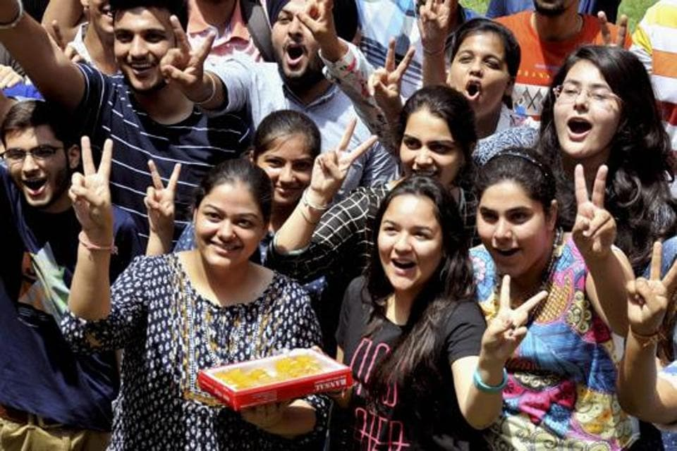Students celebrate their success after the announcement of CBSE class 12th results.