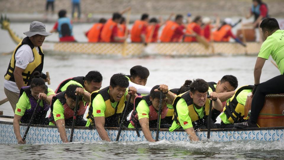 Teams of dragon boat racers paddle their boats during the Dragon Boat festival at the Olympic Water Park in Beijing. (Mark Schiefelbein / AP)