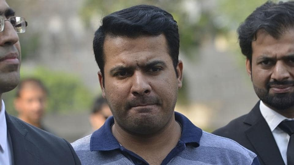 Suspended Pakistani cricketer Sharjeel Khan (C) leaves with his lawyers after appearing before a tribunal hearing into the Pakistan Super League (PSL) spot-fixing allegations against him in Lahore on May 18.