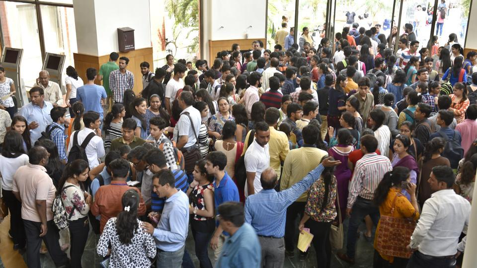 Students and parents after attending the Open Day Session in North Campus, New Delhi, on Tuesday.