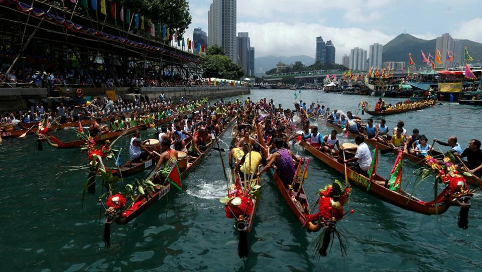 Dragon boats get together during as they take  part in the annual Tuen Ng or Dragon Boat Festival at Hong Kong's Aberdeen .  May 30th marks the fifth day of the fifth month of the traditional Chinese calendar — an annual celebration known as Duanwu in Mandarin, Tuen Ng in Cantonese and the Dragon Boat Festival in the West. It's famous for the races held on that day in traditional paddled long boats, each ornamented with a dragon's head at the prow. (REUTERS)