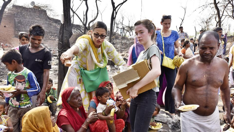 Members of the group, Amigas Latinas, distributed food, water and clothes, to those affected by the Monday morning fire.