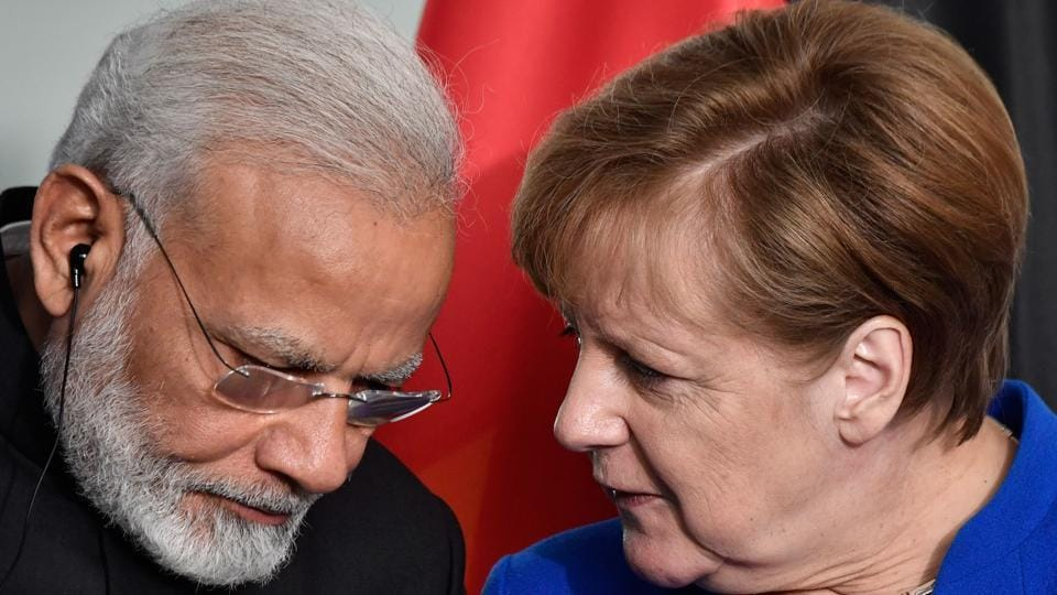 German Chancellor Angela Merkel and Indian Prime Minister Narendra Modi speak after a press conference following talks and the signing of agreements at the Chancellery in Berlin, on May 30.