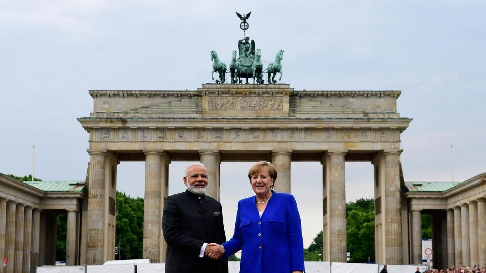 German Chancellor Angela Merkel shakes hands with Indian Prime Minister Narendra Modi in front of the Brandenburg Gate in Berlin on May 30.