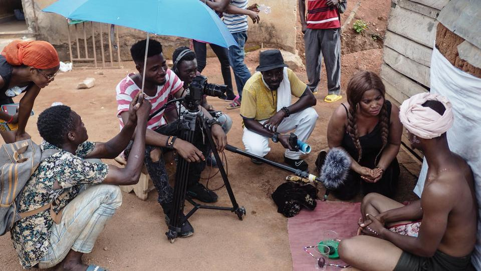 Actors and the technical camera team film a scene during the making of a Kumawood movie. These are generally low-budget movies which take about a week's time to finish recording.   (Cristina Aldehuela/AFP)