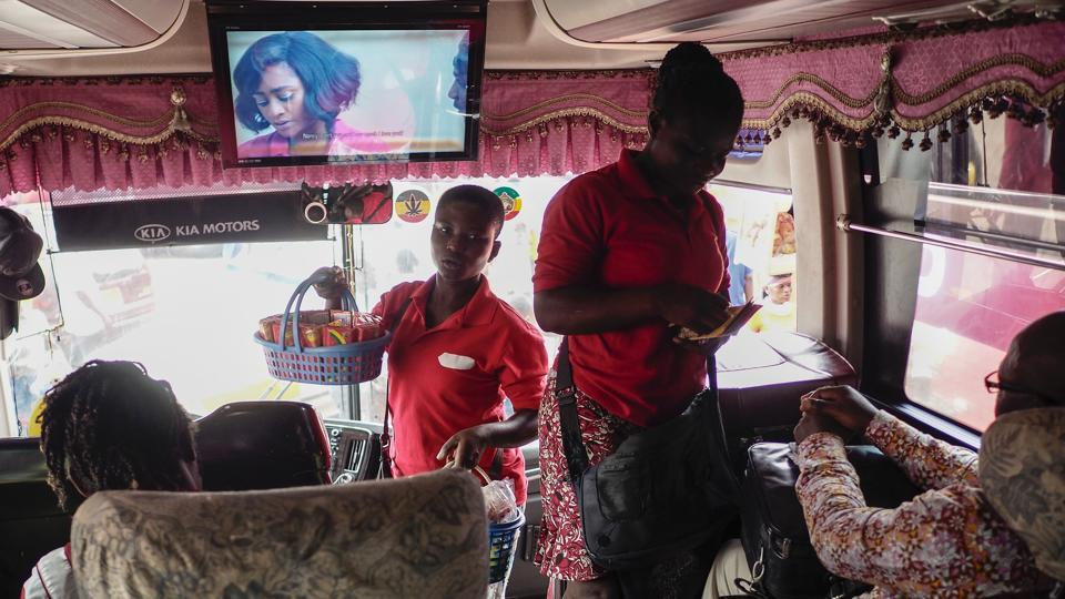 A Kumasi movie industry Kumawood popular in Ghana  is shown on a coach as people travel from Mampong across Ghana.  (Cristina Aldehuela/AFP)