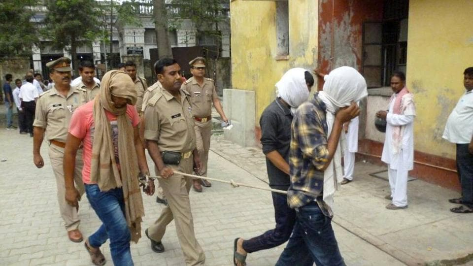 Indian police escort three suspects arrested in connection with a video posted on social media showing a sexual assault at the district court in Rampur in May 29, 2017.