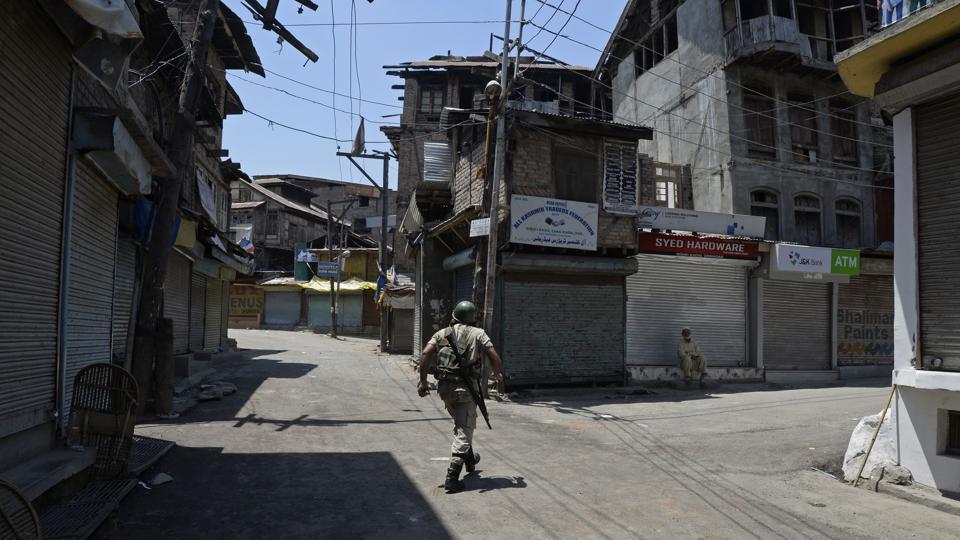 A soldier patrols during a curfew in downtown Srinagar.