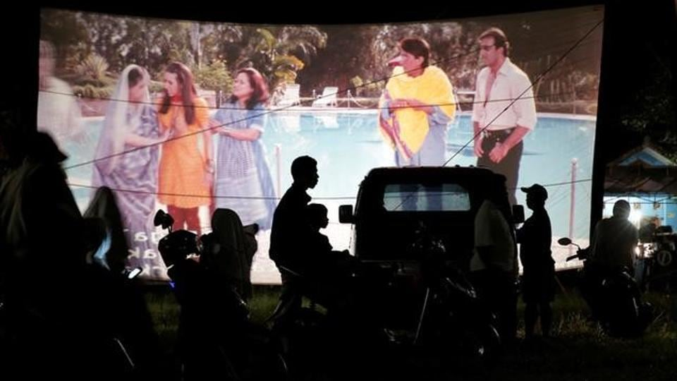 People watch a film during a wedding party in Bogor. He transports a 35-mm projector and sound system, films, a screen and large tent in his truck. (REUTERS)