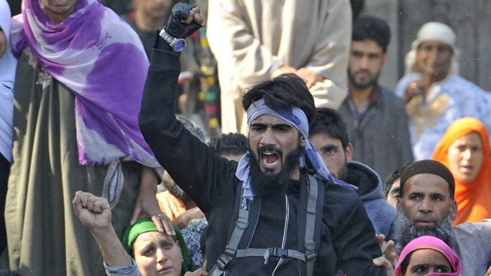 Residents shout slogans during a funeral procession of militant Sabzar Bhat at Rathsuna village in Tral.