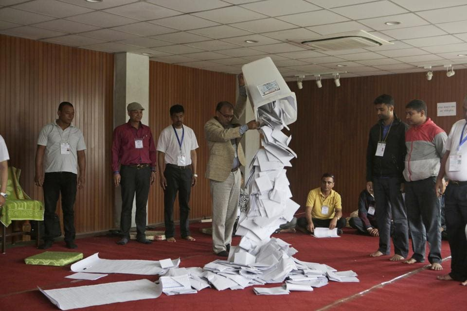 File photo of a Nepalese election commission officer emptying a ballot box prior to counting the votes in after the first phase of local elections in Kathmandu.