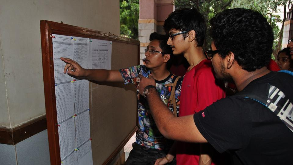 Students check their result at Thane on Monday.