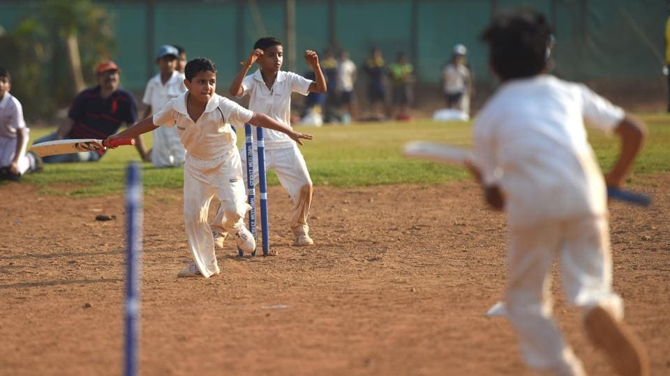 The soaring temperatures were no deterrent for these kids who beat the heat by playing cricket as a part of their summer camp activities at Shivaji Park in Dadar. (Pratik Chorge/HT Photo)