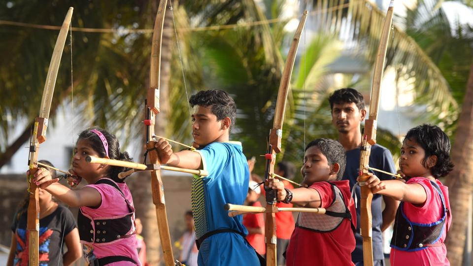 Children try their hands at hitting the bull's eye during an archery workshop at Arjuna Sports Academy in Dadar . (Pratik Chorge/HT Photo)