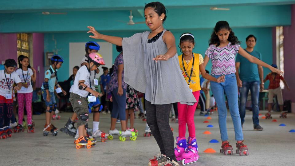 Playing it safe indoors, kids learn skating during their summer vacation at Bal Bhavan in Charni Road. (Pratik Chorge/HT Photo)