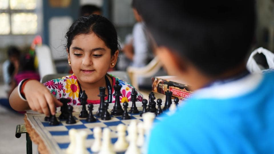 A tiny tot makes her move while learning Chess during a summer camp at Bal Bhavan, in Charni Road. (Pratik Chorge/HT Photo)