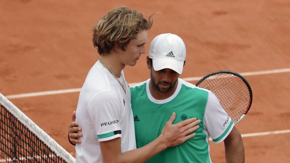 Spain's Fernando Verdasco (R) hugs Germany's Alexander Zverev after winning their match at the French Open.