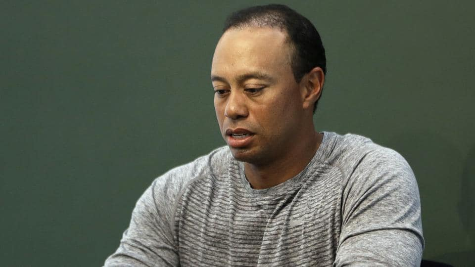 Tiger Woods blamed unexpected reaction to legal drugs for his arrest and apologised for the incident.