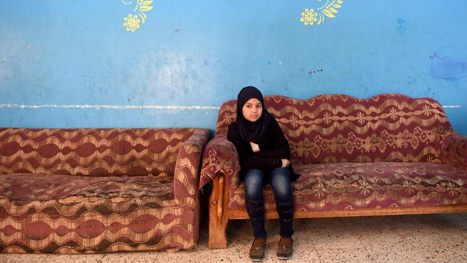 An Egyptian girl sits on a sofa at the Banati Foundation shelter, a civil society organisation that works with street children, in the capital Cairo. For Egypt's government and civil society groups, tackling the growing problem of street children, some from second- and even third-generation homeless families, is proving difficult. According to the most recent ministry figures from a 2014 survey, Egypt has about 16,000 street children, said the spokesman for the