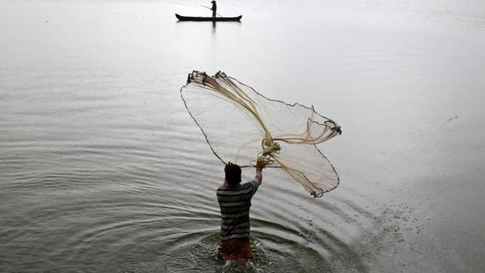 A fisherman casts his fishing net into the waters on a rainy day on the outskirts of Kochi.The regional centre in Thiruvananthapuram put out a weather warning for fishermen and people staying in coastal areas for heavy rains in the next 48 hours. (Sivaram V/Reuters)