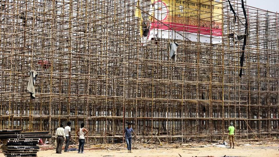Workers disassemble the stage used during the World Culture Festival organised by Sri Sri Ravi Shankar's Art of Living in New Delhi, April 02, 2016.