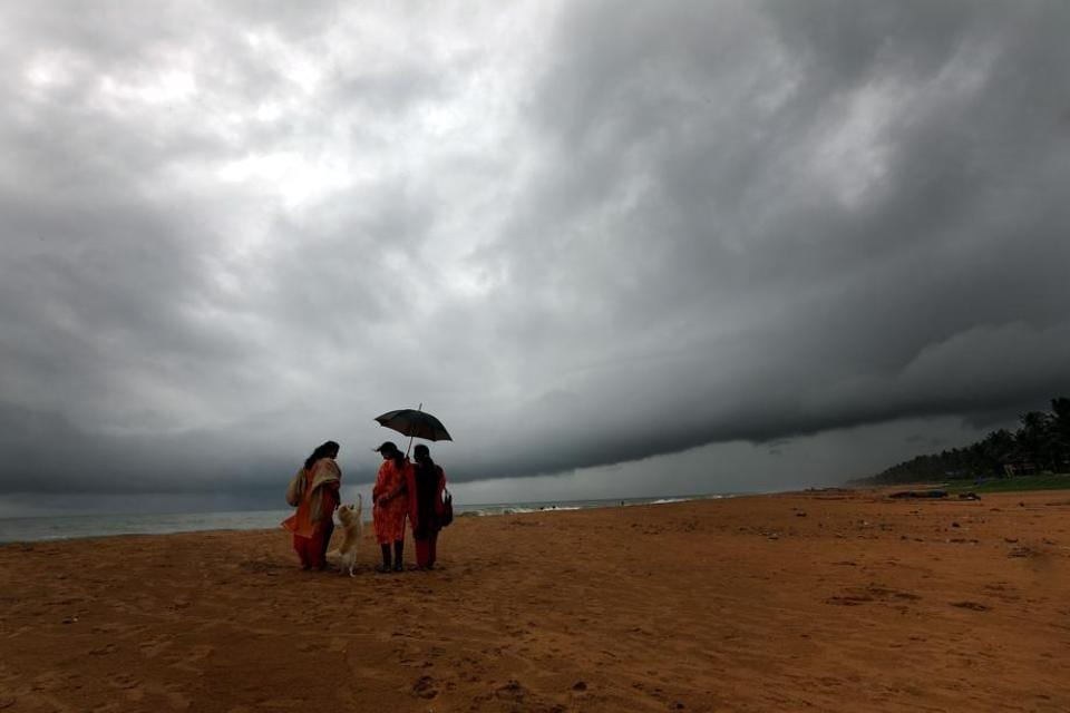 The southwest monsoon hit Kerala on Tuesday. Residents enjoy the rain at Veli beach in Thiruvananthapuram.