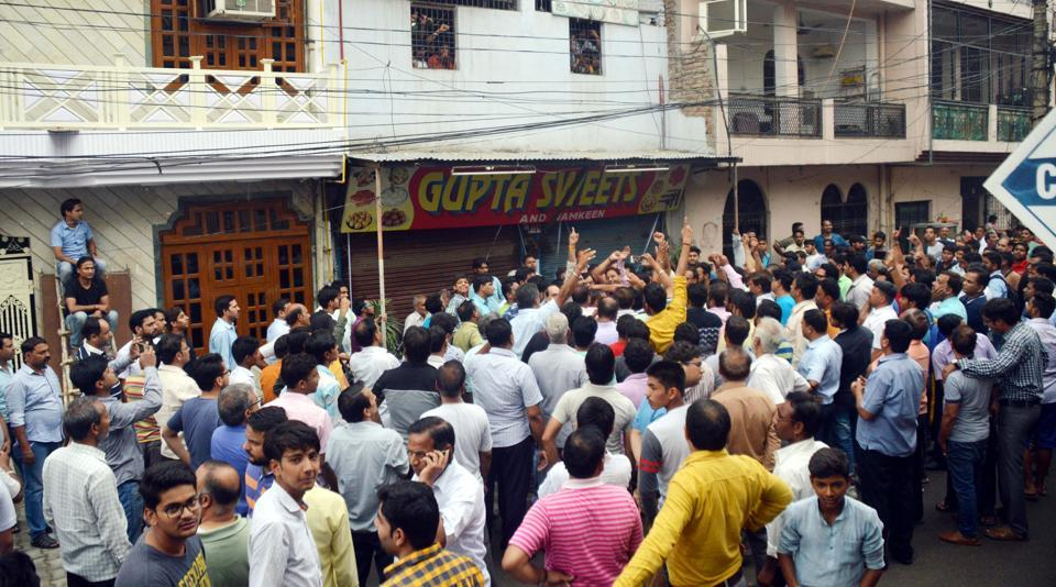 Locals said they reached the spot and found that 10 staff members inside the shop after the officials sealed the premises.
