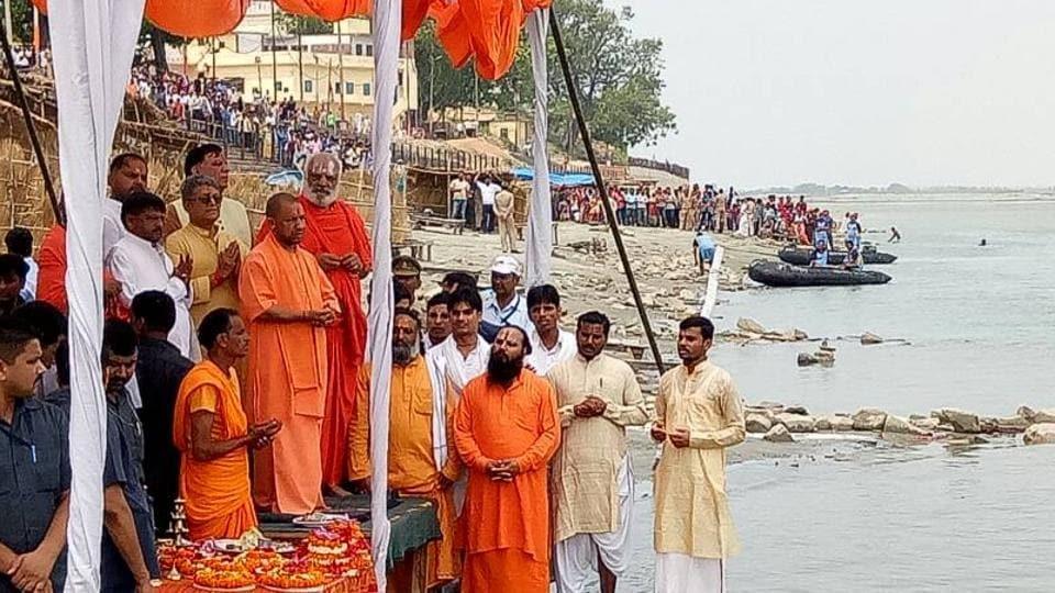 Uttar Pradesh CM Yogi Adityanath offers prayers at Sarayu river in Ayodhya.
