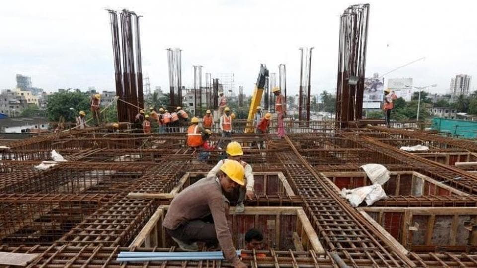 Labourers work at the construction site of a metro rail station in Kolkata.
