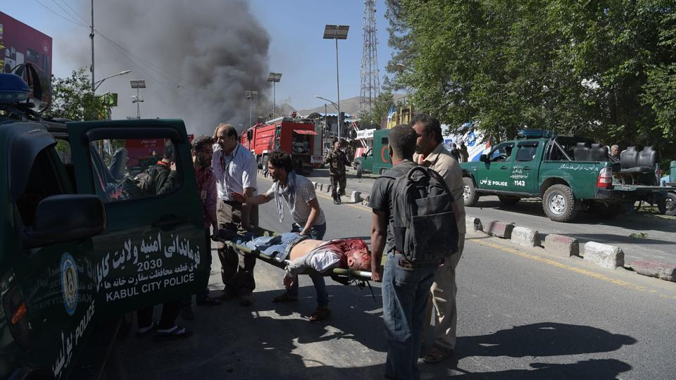 The explosion sent clouds of black smoke spiralling over the centre of the city, damaging houses hundreds of metres away. Windows and doors were blown off their hinges.  (SHAH MARAI / AFP)