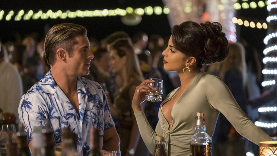 This image released by Paramount Pictures shows Zac Efron as Matt Brody, left, and Priyanka Chopra as Victoria Leeds in Baywatch.