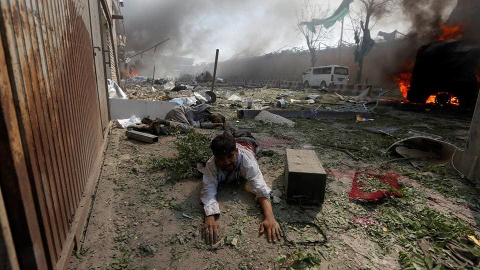 At least 80 people were killed and more than 350 wounded when a massive bomb tore through Kabul's strongly fortified diplomatic quarter during the Wednesday morning rush hour, Afghan officials said. (Omar Sobhan/ REUTERS)