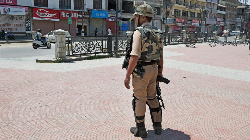 A security man stands guard at Lal Chowk in Srinagar on Tuesday.