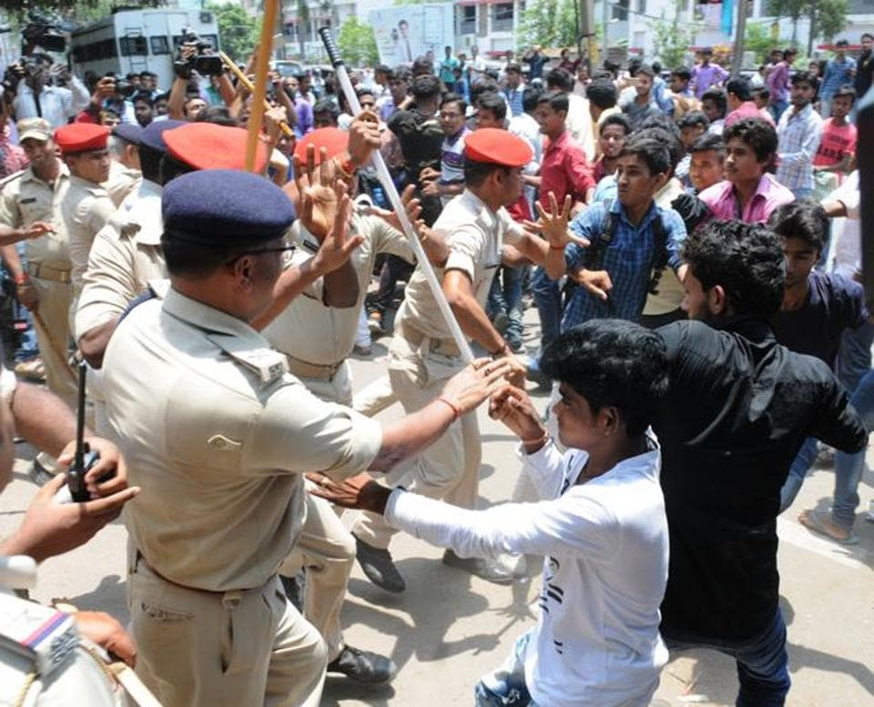 Police pushing back students protesting against poor intermediate results, in Patna on Wednesday.