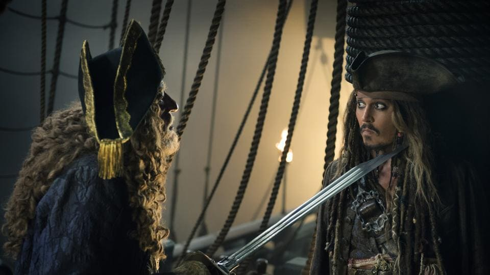 In this image released by Disney, Geoffrey Rush portrays Barbossa, left, and Johnny Depp portrays Captain Jack Sparrow in a scene from Pirates of the Caribbean: Dead Men Tell No Tales.