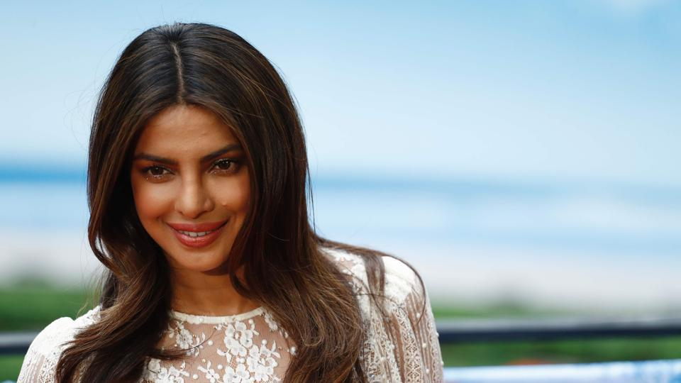 Priyanka Chopra poses for photographers during a photocall to promote Baywatch.