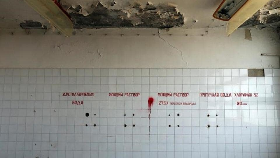 Russian writing is seen on a wall in a surgery department of a former Soviet military hospital. The place now is eerily quiet, with pigeons flying across occasionally.  (Laszlo Balogh/REUTERS)
